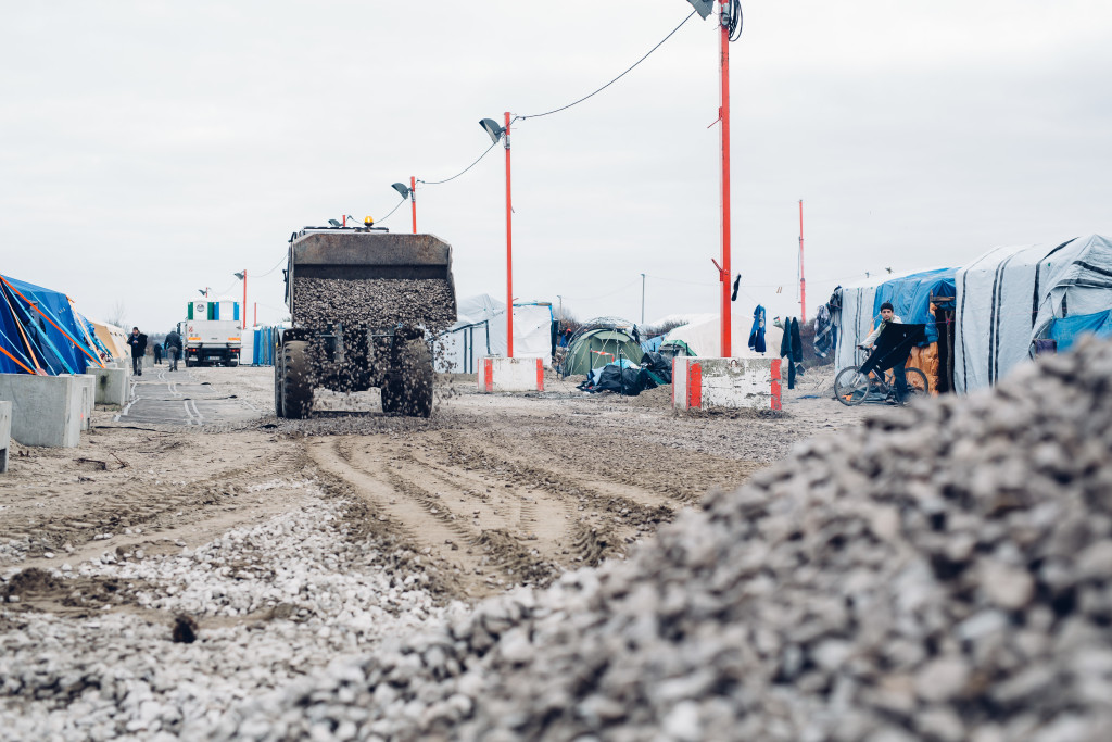 Using gravel to improve roads in the camp